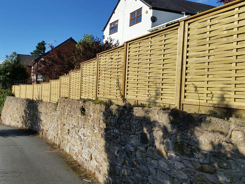 Woven panels fencing