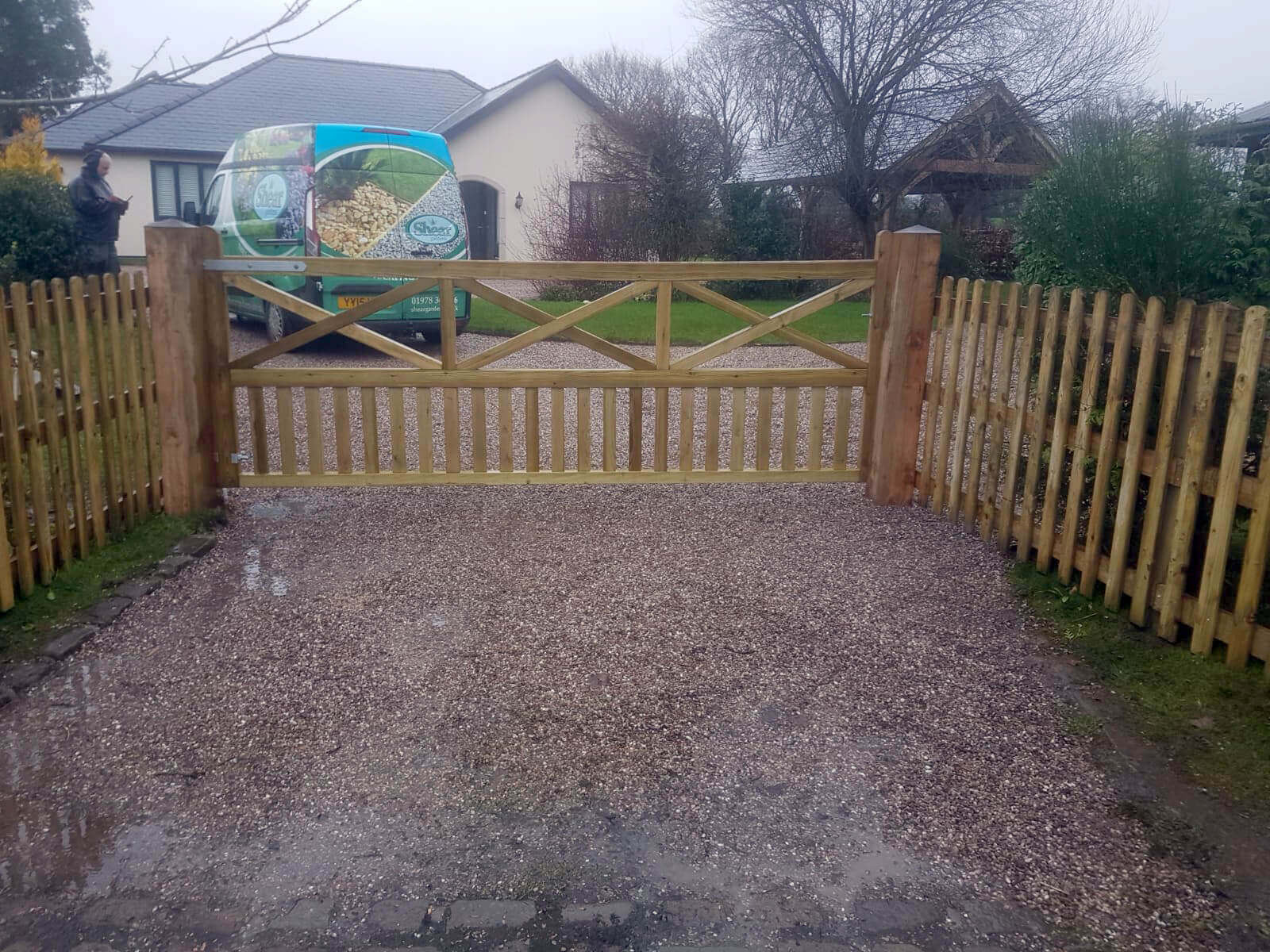 Wooden gates with palisade fencing