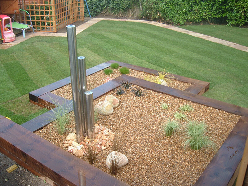 Water feature in raised bed garden in Chester