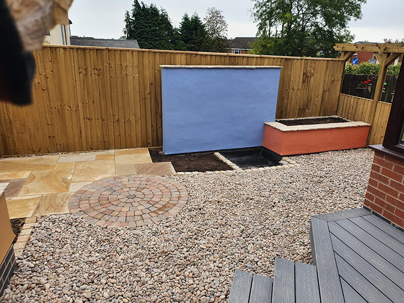 Outdoor living area with water feature in Wrexham