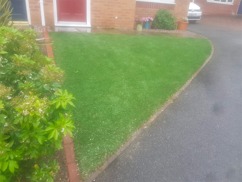 Artificial turf in front of house